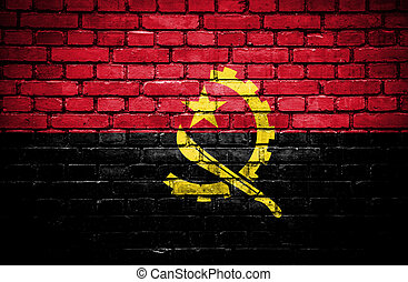 Brick wall with painted flag of Angola