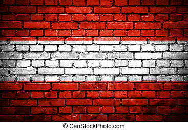 Brick wall with painted flag of Austria