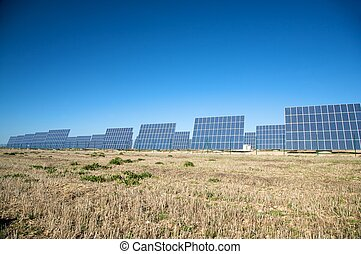 team of solar panels - solar panels with blue sky in...