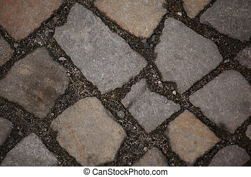 original stone texture close in berlin pedestrian walkaway...