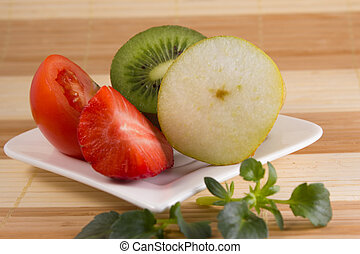 vegetarian food on a white plate with bambus background