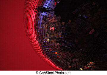 vintage disco ball close in red coloured atmosphere