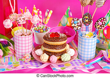 birthday party table with flowers and sweets for kids -...