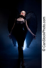 Seductive model posing in suit of fallen angel - Image of...