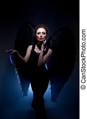 Beautiful model posing in suit of fallen angel - Image of...