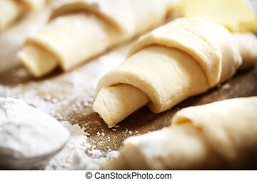 Croissants dough freshly prepared for baking with flour on...