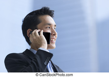 Chinese business man using a smartphone - Chinese business...
