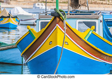 Traditional Luzzu boat at Marsaxlokk harbor in Malta. -...