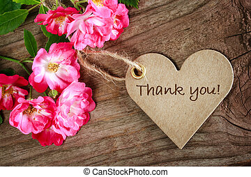 Heart shaped thank you card with flowers on wood background