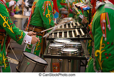 Percussion musicians take part in the Carnival parade of...