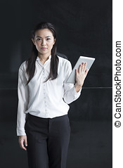 Chinese woman with a tablet computer. Asian business woman...