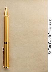 gold pen on parchment