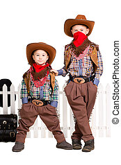 Two boys in cowboy costumes