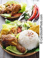 Indonesian food nasi ayam penyet - Famous traditional Malay...