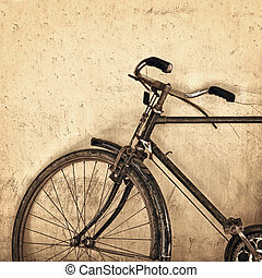 Old rusty bicycle on grunge wall background - Old rusty...