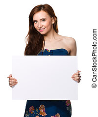 Young woman is holding blank banner, isolated over white