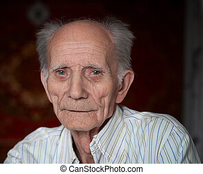 Portrait of  friendly elderly man looking up and smiling