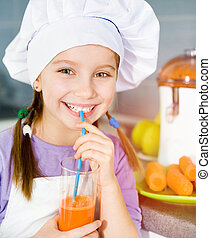 girl making fresh juice - smily little girl drink a fresh...
