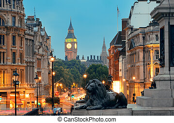 Street view of Trafalgar Square at night in London