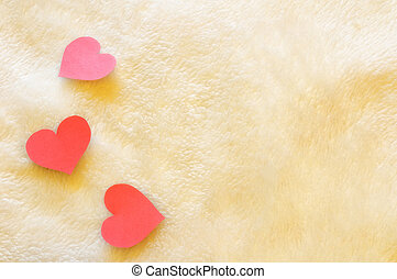three hearts on wool background - three cutout red hearts on...