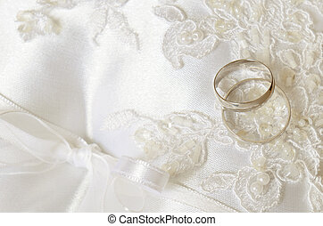 Wedding background with rings - Wedding rings on a white...
