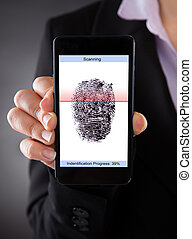 Businessperson With Cellphone Scanning A Fingerprint -...