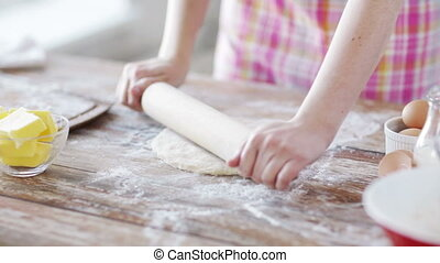 close up of female working with rolling-pin - cooking and...