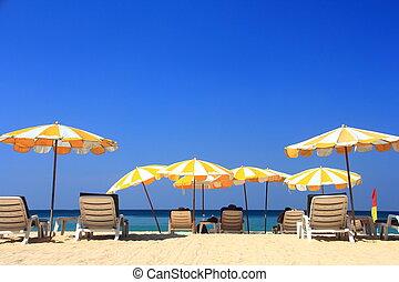 clear blue sky with beach umbrella