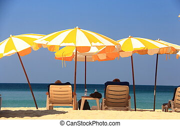 clear blue sky with beach umbrella