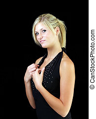 Young blond woman in black dress against dark background