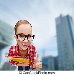 student in glasses with folders showing thumbs up -...