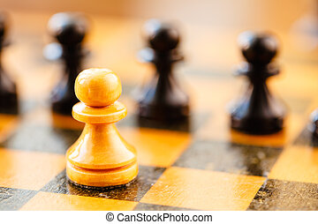 White and black chess pawns standing on chessboard - Chess...