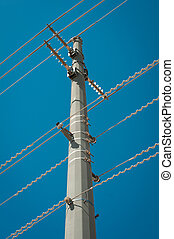 High voltage power lines on a blue sky