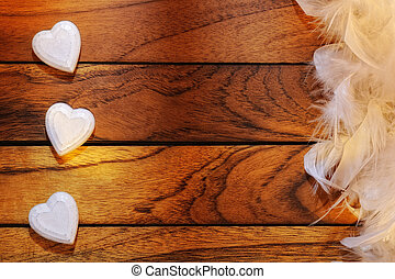 three white hearts misaligned and feathers - three white...
