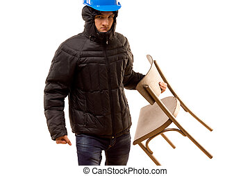 Angry young hooligan carrying a wooden chair - Angry young...