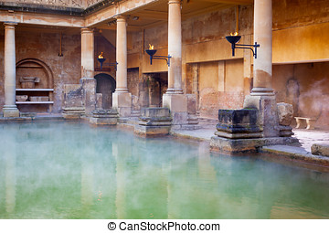 Main Pool in the Roman Baths in Bath, UK - Steam rising off...