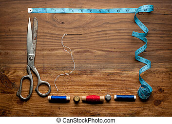 sewing tools and colored tapeSewing kit - Vintage Background...
