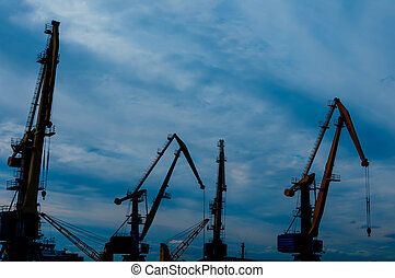 cranes at the port on sunset