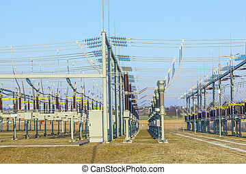 hight voltage tower in rural landscape with blue sky -...