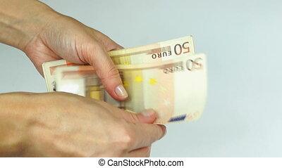 Counting Euro banknotes - Woman counting 50 Euro banknotes