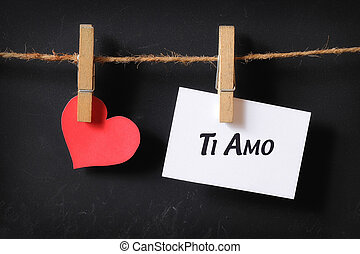 heart with ti amo poster hanging with blackboard background
