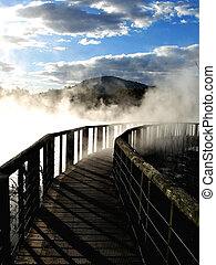 Wooden walkway through geothermal steam  in Kuirau Park, Rotorua, New Zealand