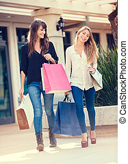 Two young women shopping at the mall