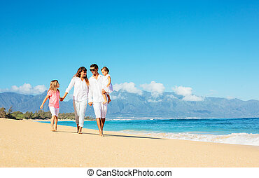 Happy Family on the Beach - Happy family walking on the...