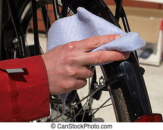 Cleaning a bicycle, closeup - Man cleaning his bike with a...