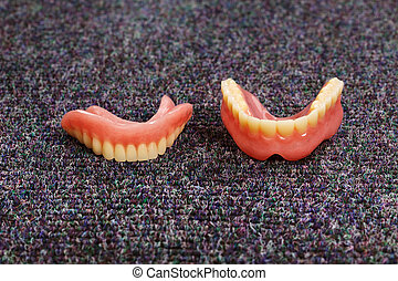 set of dentures laying on the floor