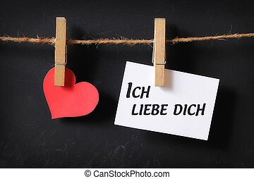 heart with ich liebe dich poster hanging with blackboard...