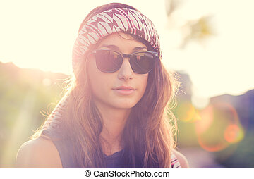 Portrait of beautiful hipster girl in glasses