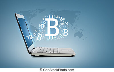 laptop computer with bitcoin - technology and advertisement...