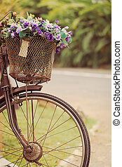 The bike basket with roses with retro filter effect